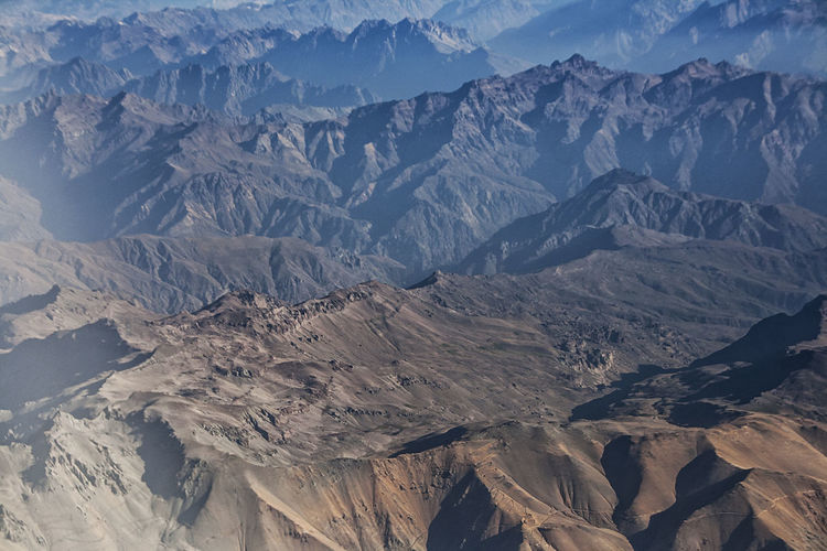 Andes Mountains aerial view Andes Chile Aerial View Arid Climate Beauty In Nature Climate Day Environment Extreme Terrain Formation Geology Idyllic Landscape Mountain Mountain Peak Mountain Range Nature No People Remote Rock Scenics - Nature Snowcapped Mountain Tranquil Scene Tranquility