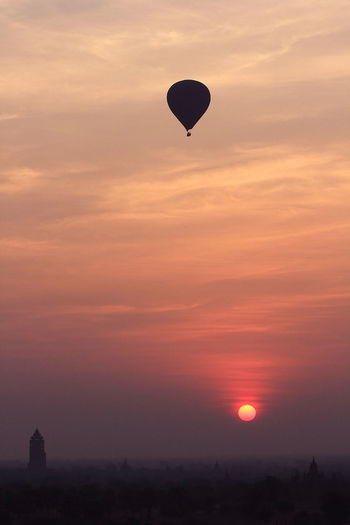 Silhouette hot air balloon against sky during sunset