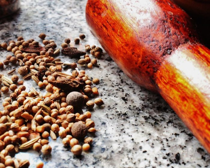 Spices of Life Spices IndianCooking Caribbeancooking Masala Grind Mortar Pestle Wooden Lifestyle Cooking Homecooking Granite Countertop Vibrant Brown Grey Close-up Cook  Create Guyana Food And Drink High Angle View Table Indoors  Food No People Close-up Healthy Eating Day