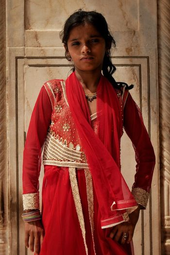The Portraitist - 2017 EyeEm Awards Traditional Clothing Looking At Camera Waist Up One Person Sari Portrait Mature Adult Beautiful Woman Only Women Standing Red One Woman Only Adults Only Bangle Real People Outdoors Built Structure Young Adult Adult