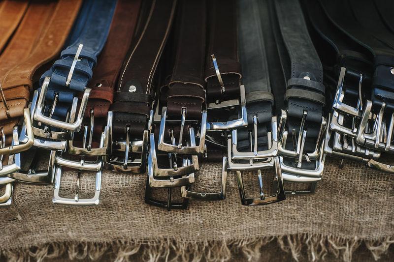 Close-up of belts on burlap
