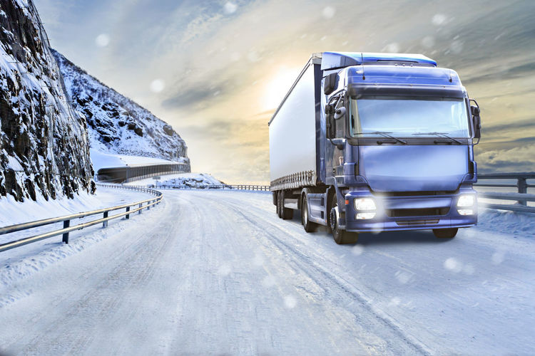 a truck on the road, symbolic picture for cargo and transportation companies Transportation Cargo Cloud - Sky Cold Temperature Day Direction Freight Transportation Land Vehicle Mode Of Transportation Motion Motorway Nature No People on the move Outdoors Road Semi-truck Sky Snow Snowcapped Mountain The Way Forward Transportation Truck Trucking Vehicle Winter