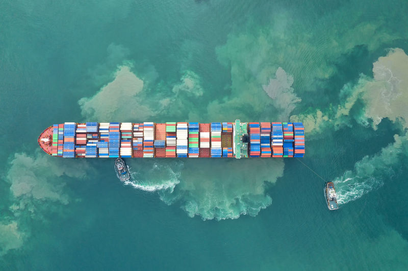 Container ship in export and import business and logistics.