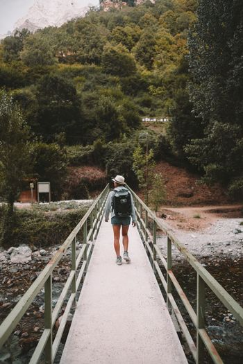 Beauty In Nature Day Footbridge Landscape Mountain Outdoors Walking Young Adult
