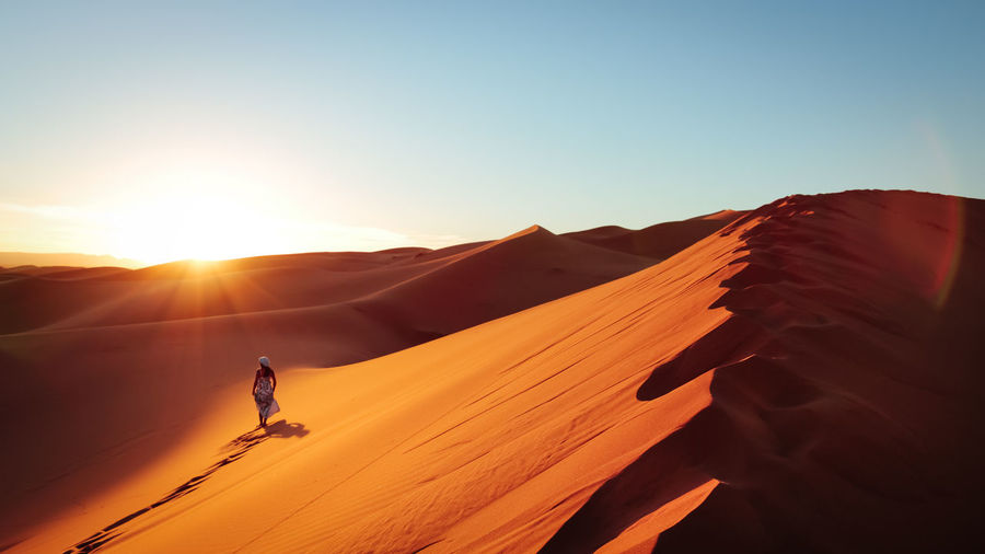Adventure Beauty In Nature Challenge Desert Dunes Extreme Sports EyeEm Selects Landscape Morocco Nature No Water One Person One Woman Only Outdoors Sahara Sahara Desert Sand Sand Dune Scenics Sun Sunlight Sunset Sunset_collection Lost In The Landscape Walking Alone...