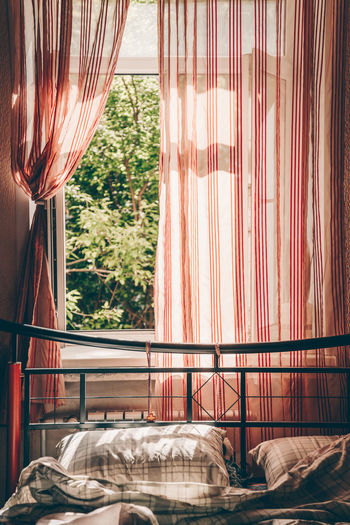 Lazy summer morning Curtain Window Indoors  Bed Glass - Material No People Textile Furniture Transparent Day Pattern Pillow Home Interior Domestic Room Bedroom Absence Nature Linen Summer Sunny Day Morning Sun