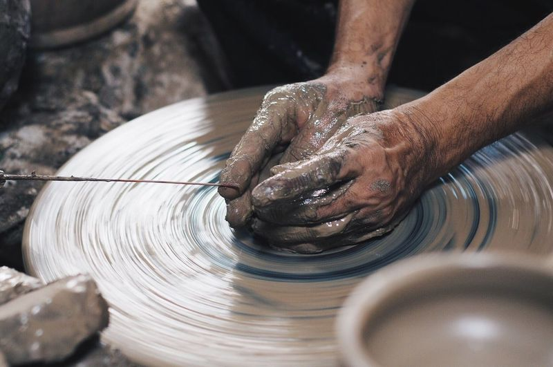potter at work in Koh Kret, Thailand Potter Human Hand Hand Human Body Part One Person Real People Art And Craft Working Pottery Making Motion