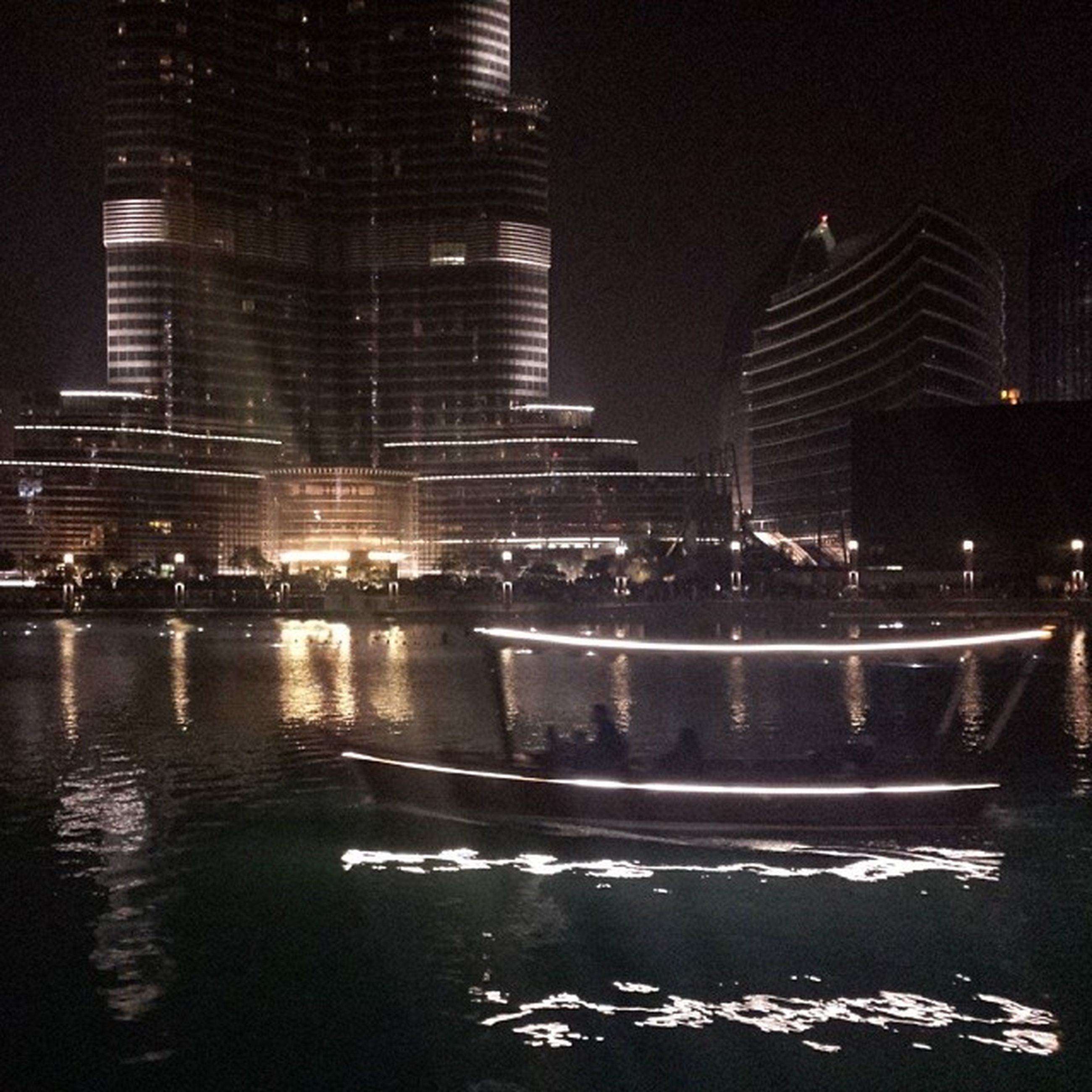 building exterior, city, architecture, night, built structure, illuminated, skyscraper, water, cityscape, office building, modern, reflection, tall - high, waterfront, building, city life, tower, urban skyline, street, river