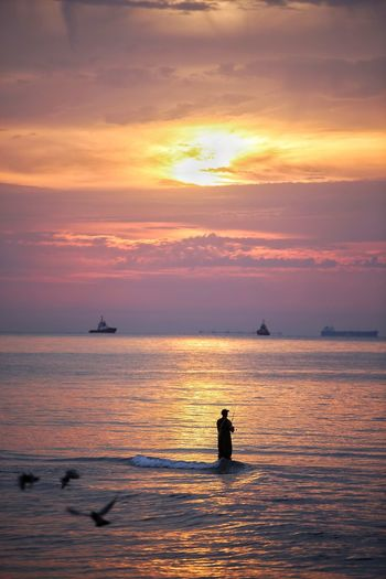 Fisherman Sunset Sky Water Sea Orange Color Beauty In Nature Cloud - Sky Scenics - Nature Silhouette Real People Nautical Vessel Horizon Over Water Horizon Transportation Tranquility Waterfront Tranquil Scene Men Nature Outdoors