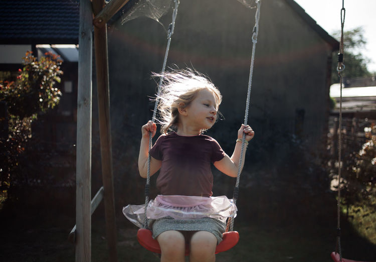 Girl on swing at playground