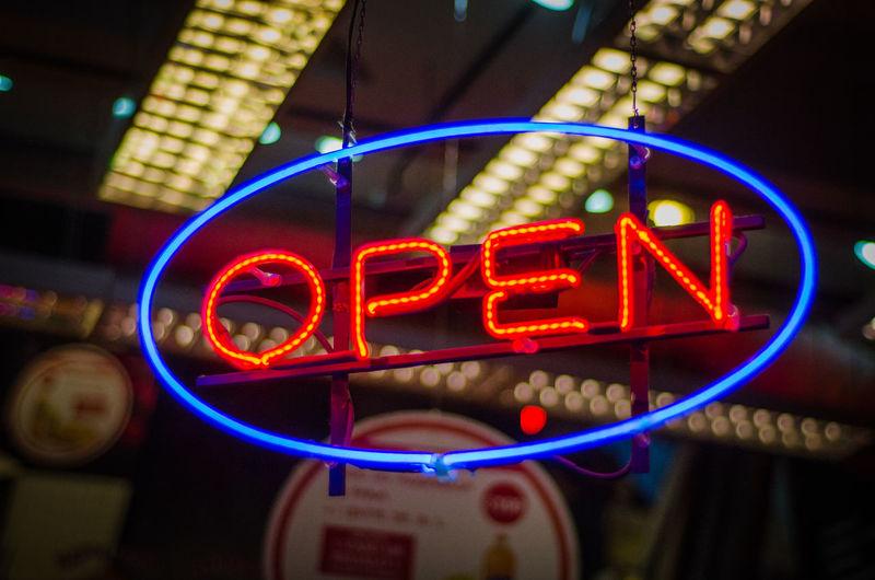 Illuminated open sign at restaurant