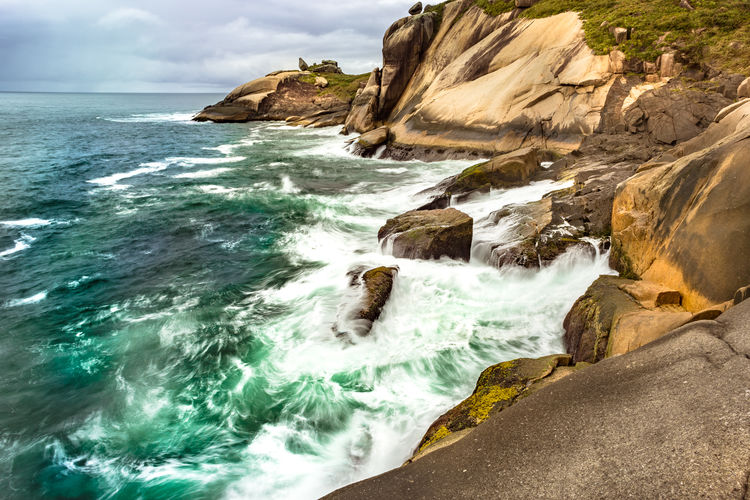 Beach Beauty In Nature Cliff Day Landscape Nature No People Outdoors Rock - Object Scenics Sea Sky Travel Destinations Water Waterfall