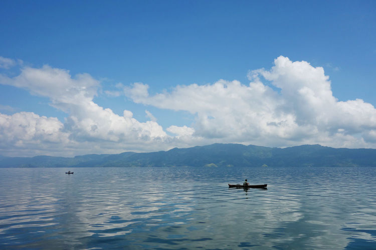 Sumatra  Toba Lake Beauty In Nature Blue Cloud - Sky Day Mode Of Transport Mountain Nature Nautical Vessel No People Outdoors Scenics Sea Sky Tranquil Scene Tranquility Transportation Water Waterfront