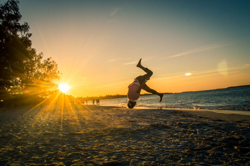 flips in the sunset Summersault Flips  Sunset_collection Parkour Parkour And Free Running Sportsman Athlete Sea Sport Sunset Full Length Men Beach Water Standing