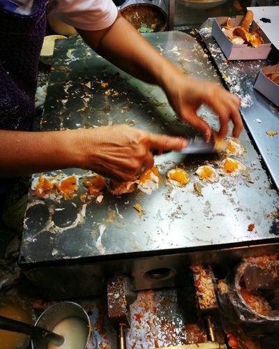 Cropped hands preparing food in kitchen
