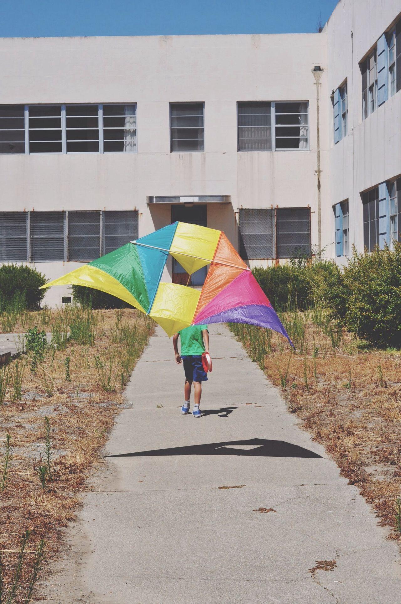 Kite flying against building