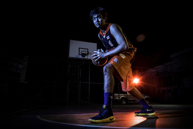 Basketball portrait with color lighting Basketball Basketball Court Basketball Game Basketball Player Basketball Portra Colorful Cool Court Fashion Flashlight Game Hansome Man Man Model Modern Outdoors Play Portrait Sport Sport At Night Sporty Sporty Man Strong Style Thailand