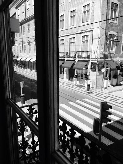 View of buildings seen through window