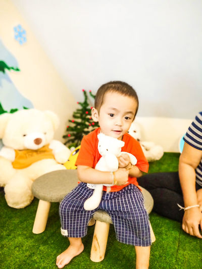asian boy Boy Sitting Portrait Happiness Child Smiling Childhood Friendship Teddy Bear Dool Happy Boy! Red Color Full Length Stuffed Toy Little Bear Toy Real People Boys Men Males  People Front View Lifestyles