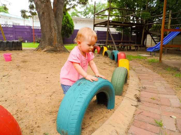 Enjoying the playground Baby Girl Toddler  Playground Playing Outside Outdoors Fun Colourful