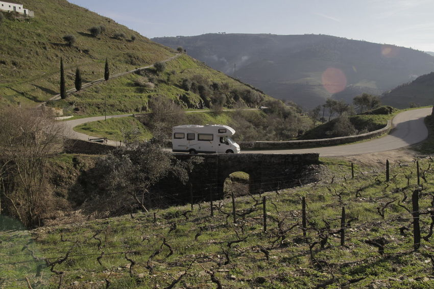 Motorhome on hillside bridge Beauty In Nature Day Grass Land Vehicle Landscape Mountain Mountain Range Nature No People Outdoors Road Scenics Sky Tranquil Scene Tranquility Transportation Tree
