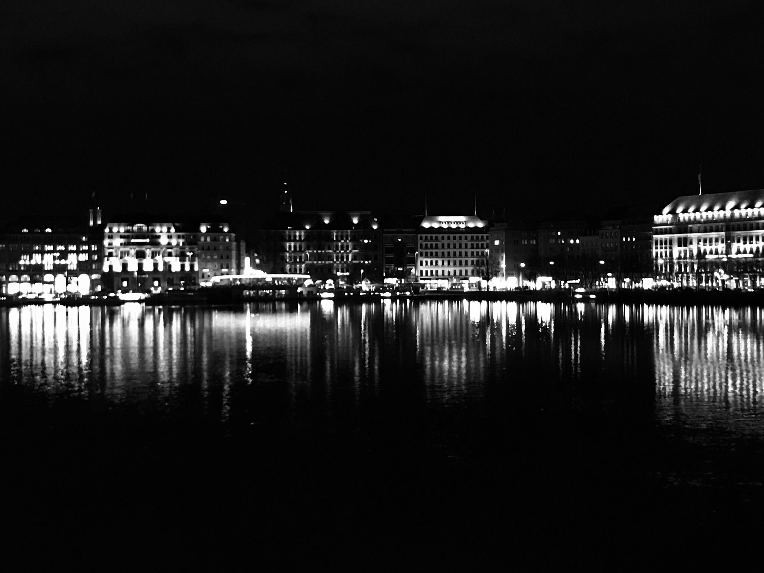 reflection, water, architecture, illuminated, building exterior, built structure, night, waterfront, river, city, no people, sky, outdoors, nature, cityscape