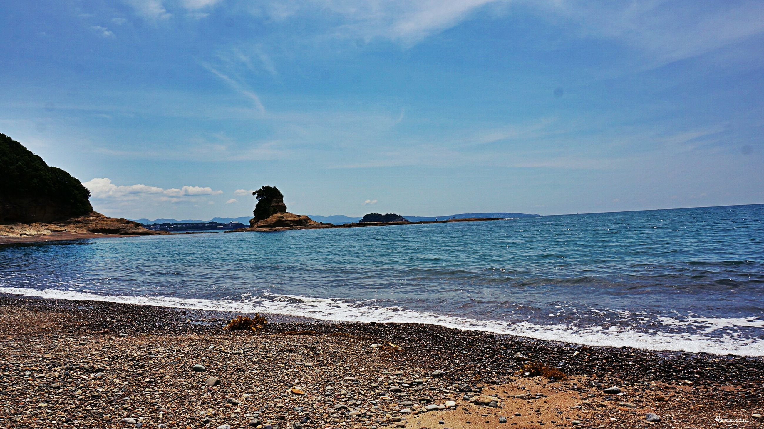 sea, water, beach, tranquil scene, shore, scenics, tranquility, sky, beauty in nature, sand, nature, horizon over water, coastline, idyllic, rock - object, blue, wave, mountain, outdoors, cloud - sky