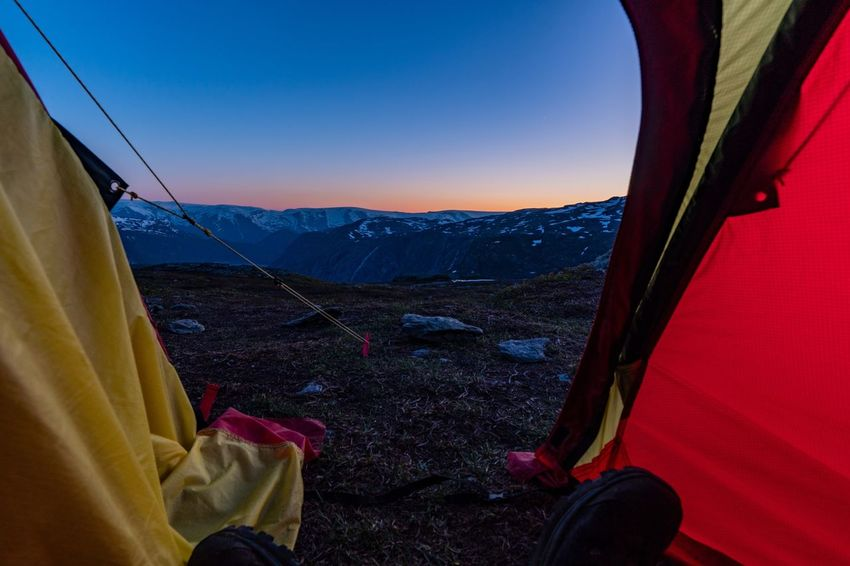 Trolltunga Sunset Camping Sunset Outdoors Outdoors Photograpghy  Hiking Adventure Mountain Sky Mountain Range Scenics - Nature Beauty In Nature Landscape Tranquil Scene Nature Tranquility Environment Non-urban Scene Tent Camping Idyllic Land Leisure Activity Clear Sky Blue Travel Human Leg The Traveler - 2018 EyeEm Awards HUAWEI Photo Award: After Dark