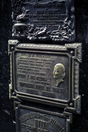 La Recoleta Cemetery, Buenos Aires, Argentina Upper class death in Argentina. The myriad of tombs and mausaleums open to the public housing the wealthy and famous of Argentine society. A macabre place of death and celebration. The Photojournalist - 2018 EyeEm Awards Architecture Art And Craft Carving - Craft Product Close-up Craft Creativity Day Female Likeness History Human Representation Male Likeness Metal No People Ornate Representation Retro Styled Sculpture Statue Text The Past