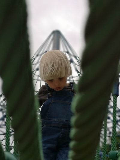 Rear view of girl on slide at playground