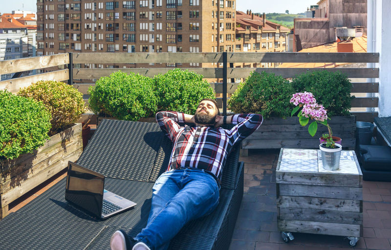 Panoramic shot of men sitting in city