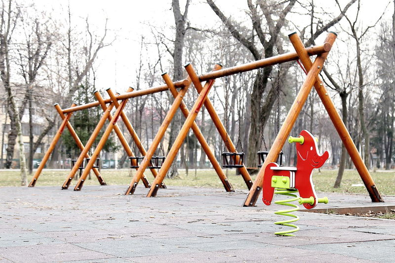 Low angle view of child playing on playground
