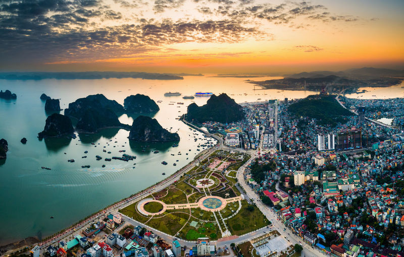 Aerial Shot Ha Long City Ha Long Aerial View Architecture Beauty In Nature Building Exterior Built Structure City Cityscape Day Ha Long Bay Halong High Angle View Horizon Over Water Nature No People Outdoors Residential  Scenics Sea Sky Sunset Town Water