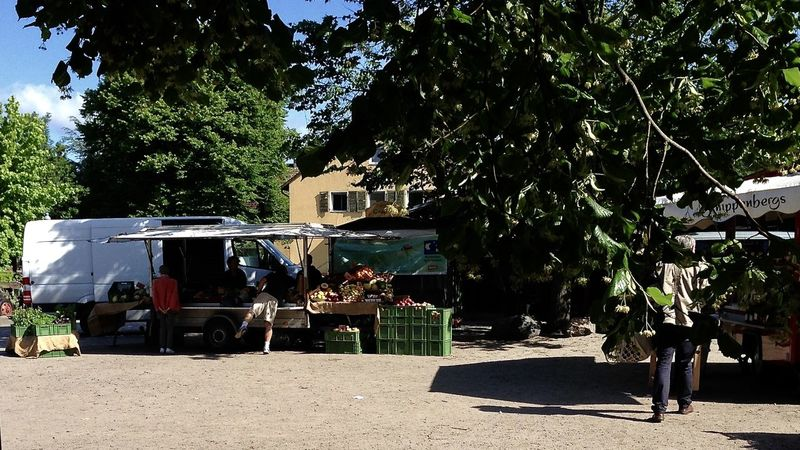 scenic view of weekly market in berlin Architecture Berliner Ansichten Bio Food Food And Drink Growth Leisure Activity Lifestyles Market Medium Group Of People Nature Organic Outdoors People Shadow Sky Streetphotography Sunlight Sunshine The Great Outdoors - 2017 EyeEm Awards The Street Photographer - 2017 EyeEm Awards Tree Vegetable Weekly Market Berlin Love Discover Berlin