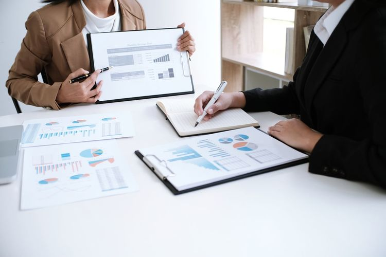 Close-up of business colleagues working in office