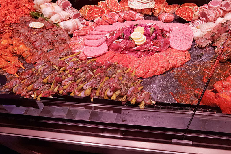 Meat department with typical german raw meat inside a supermarket. Pork chops, fresh sausage and cold cuts in the meat department. Meat Food And Drink Food Freshness Red Meat Beef Preparation  Raw Food No People High Angle View Abundance Choice Retail  Still Life For Sale Indoors  Arrangement Large Group Of Objects Close-up Variation Temptation #NotYourCliche Love Letter