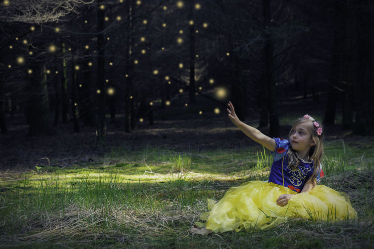 Magic fairytale Arms Raised Child Children Only Enjoyment Fun Outdoors Cheerful Tree Nature Happiness Childhood Fairytales & Dreams Fairytale  One Person Grass Lights Love Magical Snow White Forest