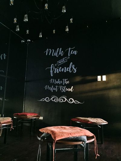 Lone time Milk Tea Tea House Tea Blackboard  Board Chair Seat Table No People Indoors  Empty Cafe Restaurant Architecture Text