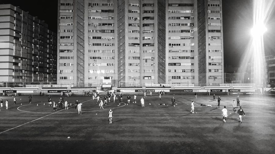 Sport Large Group Of People Architecture Building Exterior City People Outdoors Competition Only Men Real People Barcelona, Spain Barcelona Black And White Black & White Blackandwhite Light And Shadow Buildings Built Structure Football Football Field Football Game Architecture Architecturelovers Wall Sports