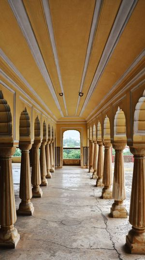 India Jaipur Aisle Arcade Arch Architectural Column Architecture Building Built Structure Ceiling Colonnade Corridor Day Diminishing Perspective Direction In A Row Incredible India No People Ornate Rajasthan The Past The Way Forward Travel Destinations Yellow Yellow Color