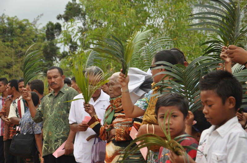Batam, Indonesia. March 2015. Indonesian Christians attend Palm Sunday Mass. Batam Batam-Indonesia Christian INDONESIA Palm Sunday People
