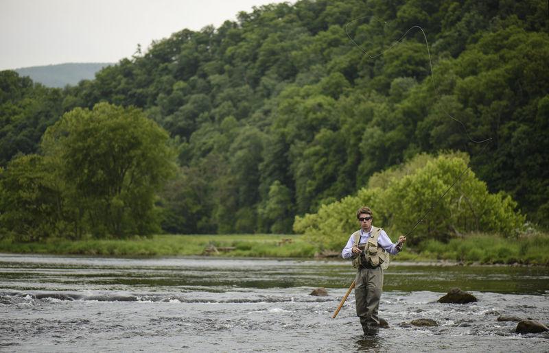Full length of man standing on riverbank