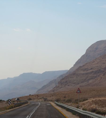 Israel Road Environment Arid Climate Outdoors No People Scenics - Nature Tranquility Beauty In Nature Mountain Range Nature Landscape Direction The Way Forward Sign Mountain Sky Transportation Road Road Sign Road Marking