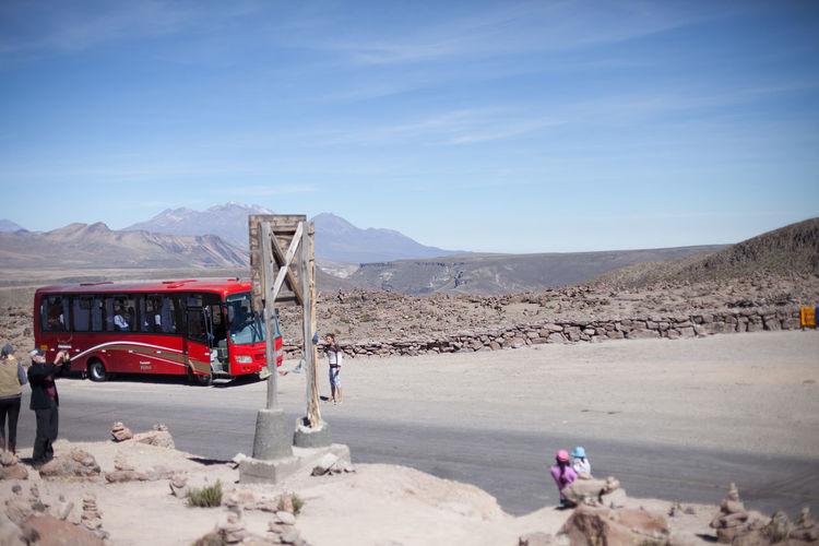 Tour Bus On Desert Against Sky
