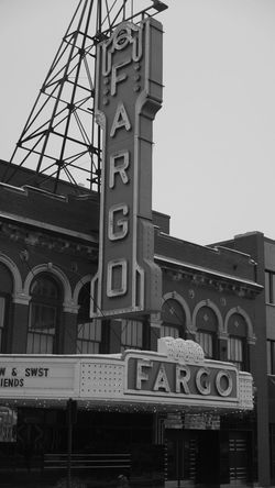 December 19, 2016 / Downtown Fargo Architecture Black And White Building Exterior Built Structure Clock Day Downtown Fargo Fargo Fargo Theatre Minute Hand Monochrome No People North Dakota Outdoors Railroad Station Sky