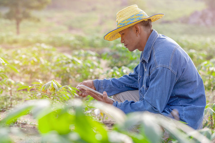 Side view of man working on field
