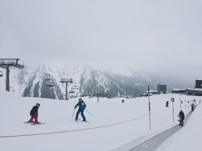 People skiing on snowy area