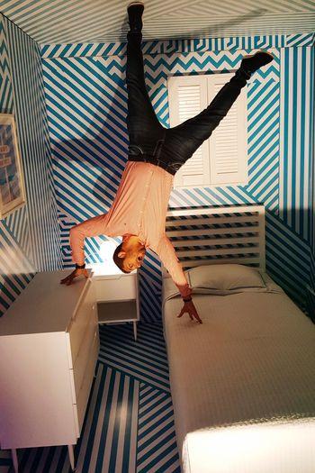 Upside down image of man in bedroom
