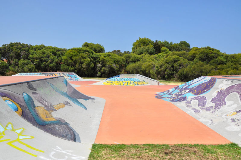 Creative urban art on the ramps at the Spearwood Skatepark in Western Australia ArtWork Colorful Concrete Creativity Day Expression Graffiti Greenery Mural No People Outdoors Playground Rails Ramps Recreation  Skatepark Spearwood Spine Sport Tagging Tree Venue Visual Statements Western Australia Youth Culture