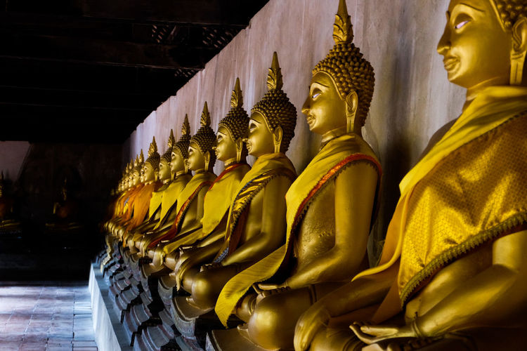 Religion Place Of Worship Statue Male Likeness Spirituality Human Representation Gold Colored Travel Destinations Cultures Gold Sculpture No People Indoors  Idol Architecture Thailand_allshots Spirituality Clear Sky Tree Blue History Ayutthaya | Thailand Ayutthaya